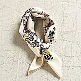 """""""When the layers come off, accessorizing gets harder, but if last year's bandana trend taught me anything, it's that a neck scarf — like this Silky Square from Urban Outfitters ($14) — is a great way to add oomph to even the simplest of outfits."""" — SS"""