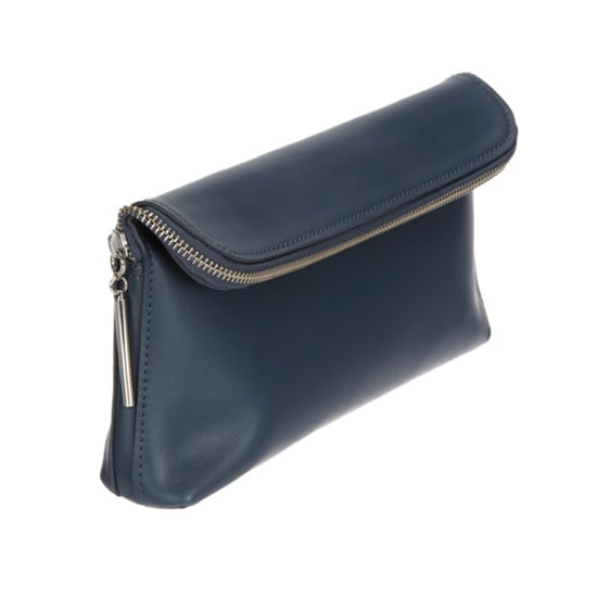 A designer travel bag will find a home in your favorite jet-setter's luggage this holiday. The 3.1 Phillip Lim 31 Minute Cosmetic Bag ($295) is just big enough to carry all the travel-size beauty essentials, and the navy leather is delightfully unisex.