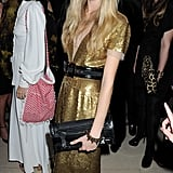 Cara Delevingne proves that a sequined frock doesn't have to be overly dressy; just finish with more modern pieces like a pair of black booties to further the cool-girl vibe.