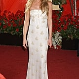 Or perhaps Jennifer was cool and casual in a patterned, strapless number? Please — someone just tell us what she wore!