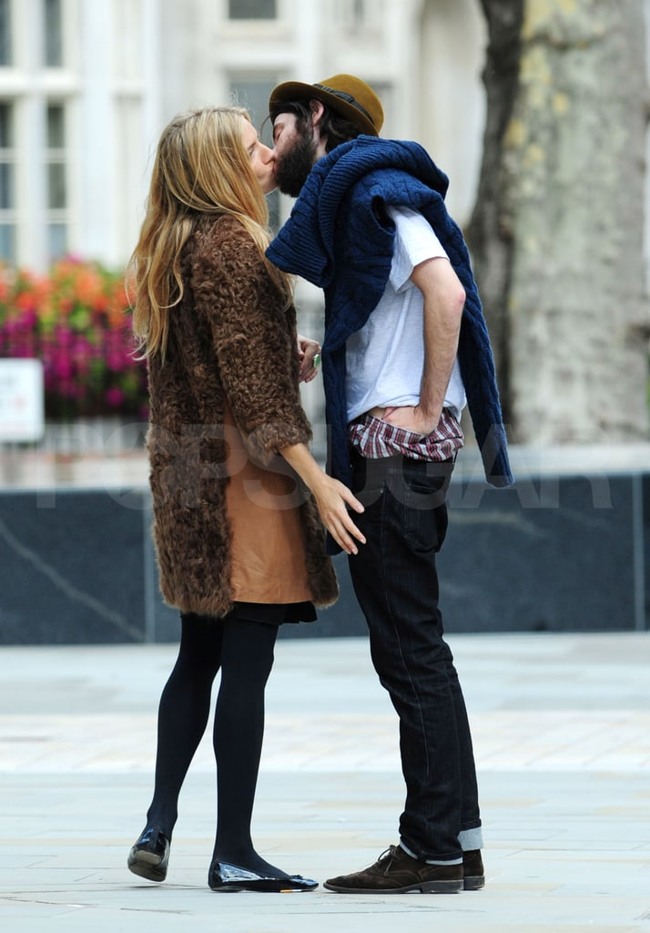 Sienna Miller and Tom Sturridge kissed today while near London's Dean Street Townhouse. It seems that temperatures in the English city are rather cold at the moment, as Sienna was bundled up in a fur-embellished jacket. Tom, meanwhile, had his lengthy beard to help him stay warm. She's home in the UK following a visit with the International Medical Corps to Ethiopia in the hopes of bringing attention to the humanitarian crisis in East Africa. Now that she's back, there are fashion and family to consider. Her sister Savannah is nearing the due date for her third child and tweeted about just booking a birthing pool for the big occasion. Savannah and Sienna are also gearing up to present their latest Twenty8Twelve designs during London Fashion Week.