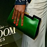 Solange Knowles carried an emerald-green-and-black clutch.