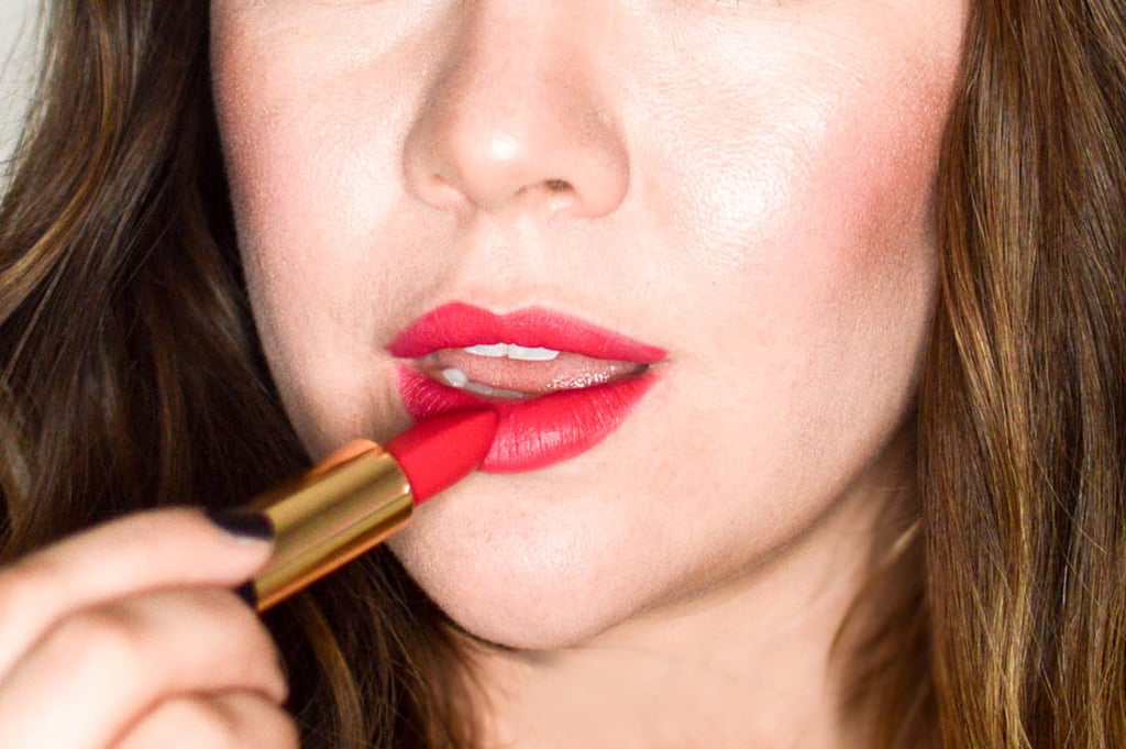 When using both a gloss and lipstick, I prefer to use a matte lipstick so that the gloss will not muddy the color underneath. We suggest Oribe Lip Lust Crème Lipstick in The Red ($42).
