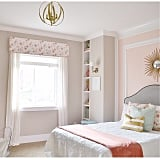 The find: the white bedding in this pastel and gold bedroom.