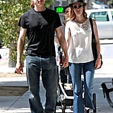 January Jones held hands with Noah Miller while running errands around LA in August.