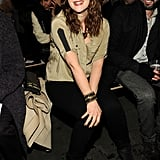 Drew Barrymore smiled wide in a silky olive blouse, brown hat, and CC Skye cuff while sitting front row at Rag & Bone.