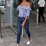 Jourdan Dunn channels the preppy side in a pinstriped cold-shouder top and white loafers.