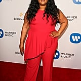 Thought this was a dress? Nope. Lizzo's unique silhouettes and bright colour choices make outfits like this cherry red jumpsuit stand out at every event the singer attends.