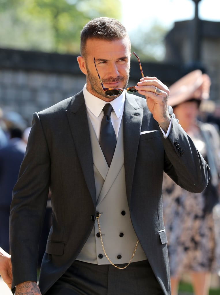 Before Prince Harry saw Meghan Markle for the first time and the tears started flowing, 600 fabulous guests made their way into St George's Chapel. Yep, 600 guests, and a ton of celebrities, but we just couldn't stop staring at David Beckham. The 43-year-old athlete looked incredibly dapper as he walked into the royal wedding ceremony alongside Victoria with a pair of sunglasses on. After attending Prince William and Kate Middleton's wedding back in 2011, we had a feeling the Beckhams would be there, but nothing could've prepared us for the smoke show that was David's good looks. Read on to see his royal wedding photos, but bring your sunglasses for all that heat.      Related:                                                                                                           See Every Single Stunning Photo From Prince Harry and Meghan Markle's Royal Wedding!