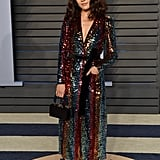 Wearing a sparkly Markarian dress, Edie Parker clutch, and Alexis Bittar jewels at the 2018 Vanity Fair Oscar Party.