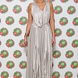 Whitney Port wore the AllSaints Heather maxi dress with eclectic gold jewelry and gladiator flats.
