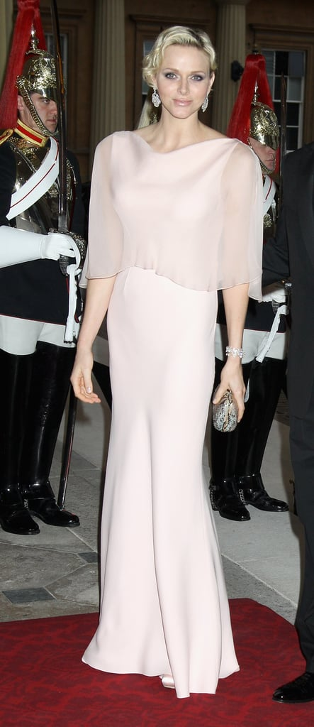 Charlene donned a breathtaking evening look in a soft pastel gown at a dinner at Buckingham Palace in May 2012.
