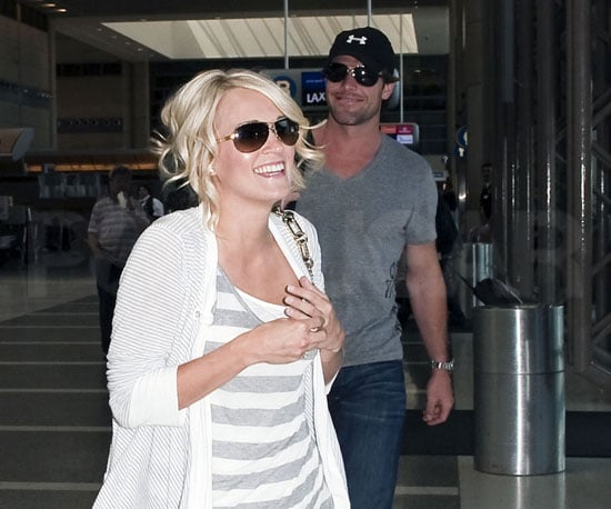 Slide Picture of Carrie Underwood and Mike Fisher Newlyweds at LAX