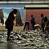 People sort through the damage outside of stores in Baton Rouge, LA.