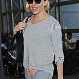 Sienna Miller glowed without makeup at LAX on Saturday.