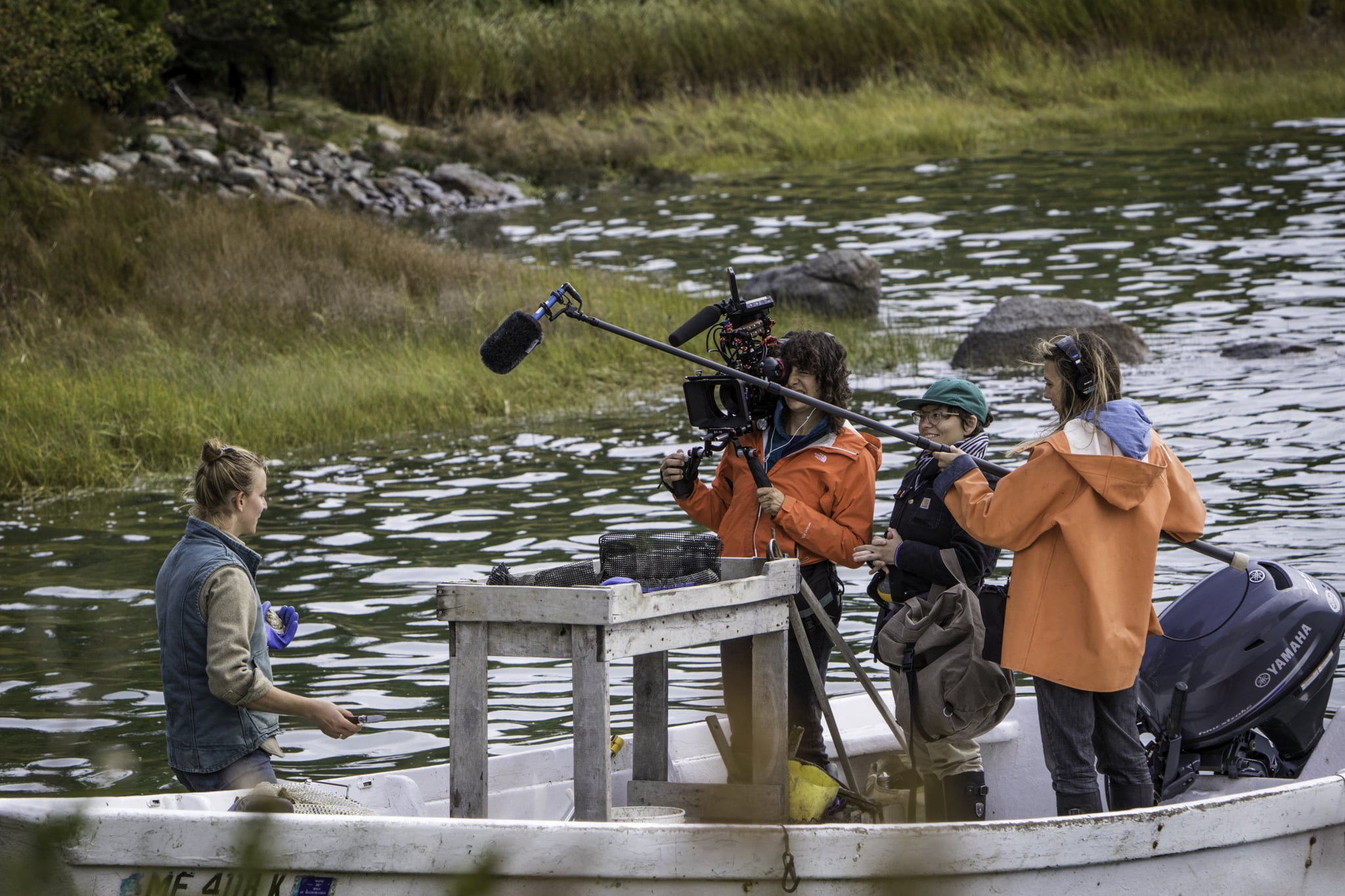DEER ISLE, ME 9/3/17 10:30:37 AM The crew films Abby Barrows on her boat at Long Cove Sea Farm, her oyster farm in Deer Isle, Maine, on Sunday, September 3, 2017.  Photo by Sarah Rice