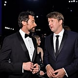 Hugh Jackman chatted with Les Mis director Tom Hooper in the crowd.