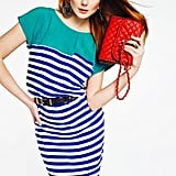 Don't be afraid to contrast a bright striped dress with an equally eye-catching bag. We love how Eniko works the red and blue combo.
