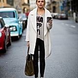With a Slogan Tee, a Duster Coat, and Black Skinny Jeans