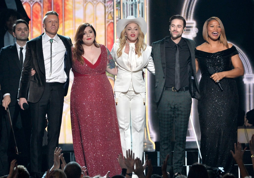Macklemore & Ryan Lewis performed with Madonna and Mary Lambert at the Grammys. They were joined by Queen Latifah, who officiated a mass wedding during their song.