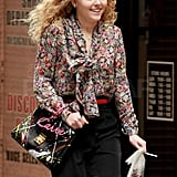AnnaSophia Robb looked very Carrie with a graffiti-style purse.
