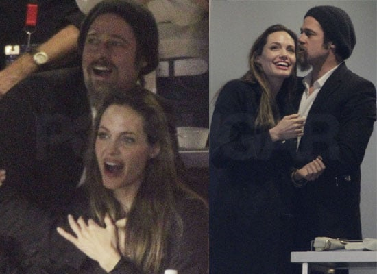 Photos of Angelina Jolie and Brad Pitt Cuddling Up and Showing Affection at the Super Bowl 2010
