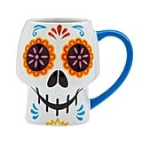 For those who aren't really alive until the first cup of coffee hits, you'll appreciate this beautiful Coco Skull Mug ($17).