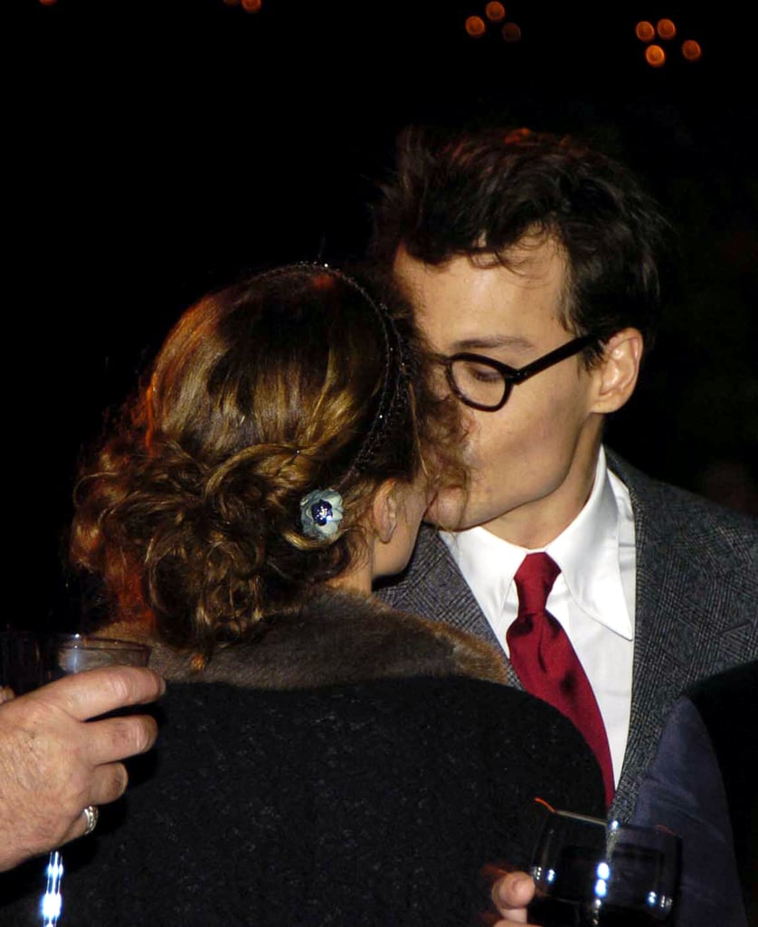 The couple kissed during a 2004 charity event in London.