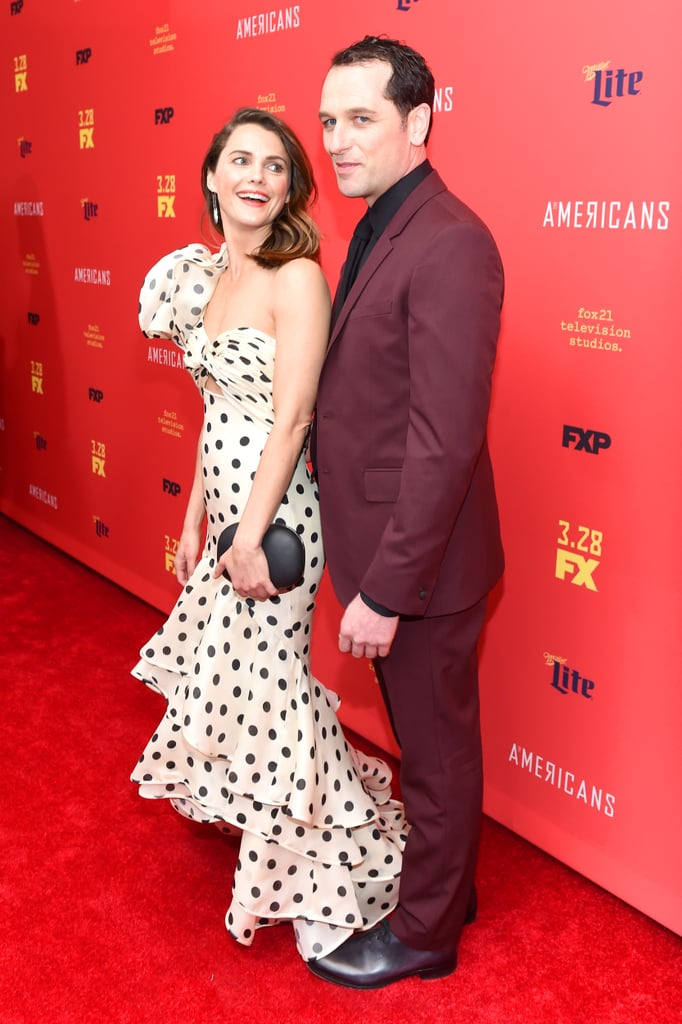 Keri Russell and Matthew Rhys continued their streak of being the most adorable couple at the red carpet premiere of the final season of The Americans in NYC on Friday. The duo, who sparked up a romance when they first met on the set back in 2013, were all smiles — and giggles! — as they couldn't stop laughing while posing for pictures. Keep reading to see more photos of their sweet outing, then check out Keri and Matthew's cutest moments together over the years. Seriously, these two are #CoupleGoals!