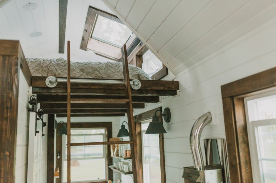 Instead of space-hogging stairs, the home's portable ladder makes it easy to access anything out of reach – including the bedroom loft.