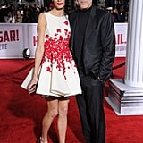 Wearing a red floral Giambattista Valli fit-and-flare dress with silver Dior heels and Lorraine Schwartz jewels at the Hail, Caesar! premiere in 2016.