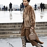 Winter Outfit Idea: A Furry Bomber and Sleek Dress With Boots