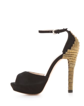The gold detailing and sexy silhouette on these L.k. bennett Bellini Peep Toe Sandals ($382) also comes with a much more walkable platform so you don't have to sacrifice comfort for style.