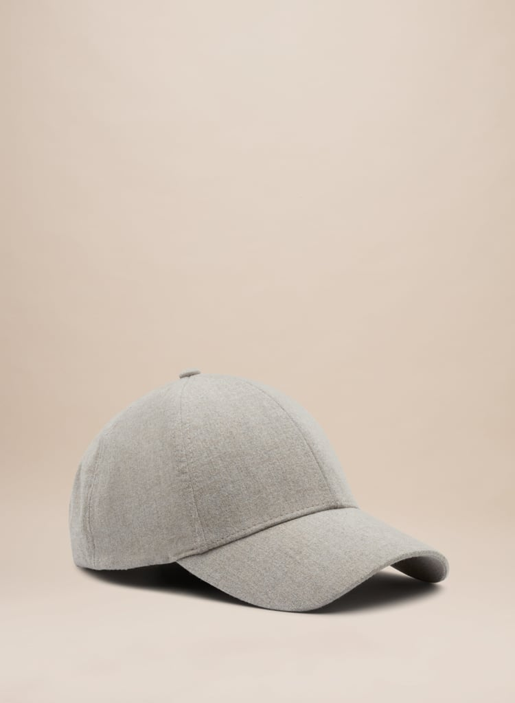 """Admittedly, I'm not a big fan of hats because they don't look good on me. I still love to try them on, however, hoping one will finally fit. I think The Group by Babaton's Gray Snapback ($40) will be the solution to my hat problems."" — ML"