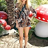 Nicole Richie makes her cutofffs event appropriate with statement shades, a bold blouse, and standout platforms.
