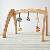 Land of Nod Wooden Baby Gym With Punctuation Rattles