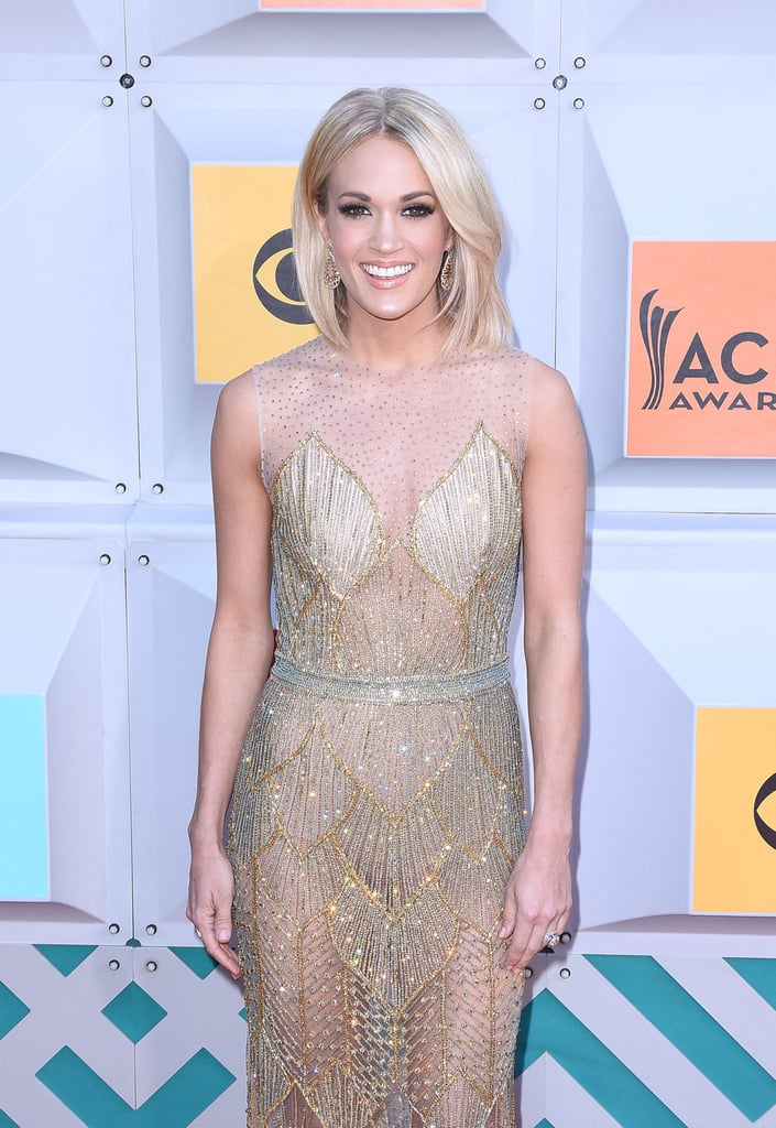Carrie Underwood is one hot mama! On Sunday, the country singer made her way to the MGM Grand Garden Arena in Las Vegas for the annual ACM Awards. Upon her arrival, Carrie turned heads in a sheer, beaded number and struck a handful of poses for photographers on the red carpet. Carrie also took the stage for an amazing performance and was spotted mingling with Keith Urban backstage. Read on for more of Carrie's night, and then check out this sweet family moment she shared with her husband and son last month.
