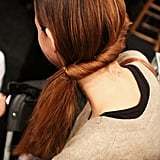 Finish the ponytail with a bit of Heat Tamer Spray, and smooth the ends with a blow dryer for a sleek, over-the-shoulder ponytail.