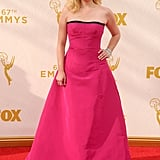 She wore a magenta pink Oscar de la Renta dress to the 2015 Emmys.