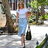 Karlie Kloss gave her tee a springtime spin with a pale blue knee-length skirt.