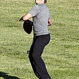 Pictures of Tom Brady Tossing a Football Around With His Trainer in LA