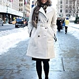 Carine Roitfeld echoed the color of her crisp coat with a pair of white heels.
