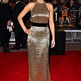 Jennifer Lawrence glowed at the London premiere of The Hunger Games, wearing a custom gold crocodile print Ralph Lauren gown.