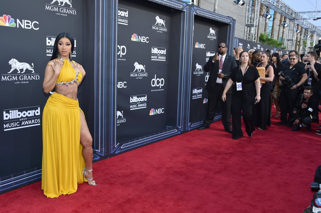 "Just when we thought the 2019 Billboard Music Awards couldn't get any sexier, Cardi B strolled onto the red carpet in a jaw-dropping two piece. Not only does the rapper look incredible, but she's also giving us serious Cher vibes and we can't help but think ""I like it like that!"" Whatever her workout regimen is, we need the details, ASAP. Cardi has a huge night ahead of her, leading the pack with 21 nominations in 18 categories (because when a boss does anything, she does the damn thing) and is even competing against herself in several categories. We can't wait to see what she ends up taking home! Ahead, check out more photos of the rapper and her partner on their night at the BBMAs.       Related:                                                                                                           Cardi B's Golden Two-Piece Shows Off Every Curve, and I Like It Like That"