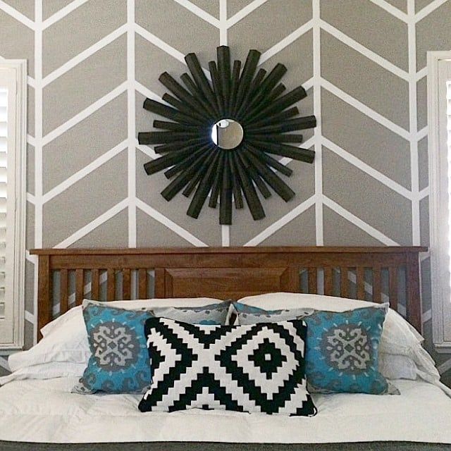 The finds: a sunburst mirror and some patterned blue pillows.