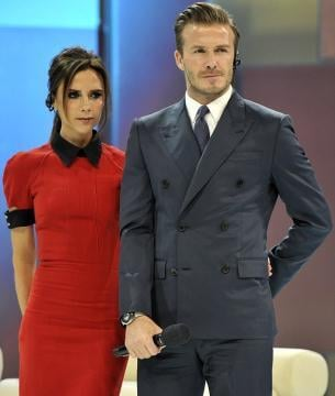 """Victoria Beckham shared a snap of her and David Beckham's appearance on China Central Television and joked, """"Does anyone else thing DB looks like Kevin Costner from the Bodyguard? Nice ear piece."""" Source: Twitter user victoriabeckham"""