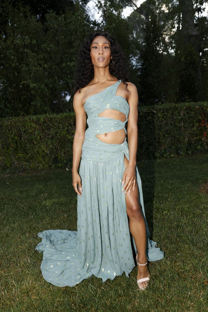 Mj Rodriguez made an unforgettable impression on the Cannes Film Festival scene this year. Days after walking the red carpet in a breathtaking backless gown, the Emmy-nominated Pose actress made an appearance at the annual amfAR Gala wearing another gorgeous Etro piece. The seafoam-green gown wrapped around Mj in all the right ways, striking the perfect sexy-chic balance.  Mj's one-shoulder dress featured several cutouts along her midriff and a high slit at the leg, giving her a goddess-like appearance as the fabric floated behind when she strolled around. She kept her accessories minimal and stuck to neutral tones for her shoes and makeup. Let the dress do the talking! It's a conversation piece. We're gearing up to see more red carpet looks from Mj during award season, and if her looks are anything like this one, we'll be thrilled. See more photos from her night at the amfAR event ahead.       Related:                                                                                                           Mj Rodriguez Has Worn Every Color and Cutout Under the Sun — See Her 22 Best Looks