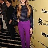 Shailene Woodley went for a classic look with a printed silk top and purple trousers from Honor.