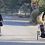 Julia and Daniel trailed behind with their youngest son, Henry, in tow.