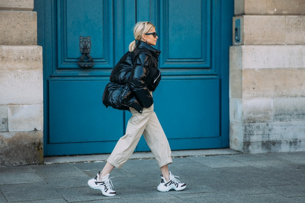 Caroline Daur wore two of the season's biggest trends - puffer coats and Louis Vuitton dad sneakers.